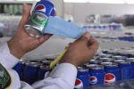 """بالصور: إحباط تهريب 48 ألف عبوة """"بيرة"""" إلى السعودية"""