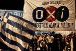 'لا' اليونانية تهبط بالنفط واليورو والأسهم