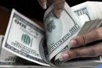 انخفاض الدولار متأثرا بهبوط الأسهم