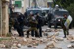 اعتقال 16 في الضفة واصابات خلال اقتحام مخيم الدهيشة