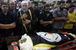 آلاف المواطنين يشيعون جثمان الشهيد أبو العطا