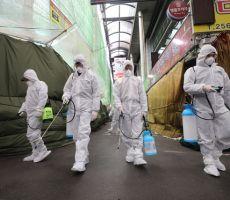 الصين تعلن رقما جديدا لضحايا كورونا.. والخشية من 'المسافرين'