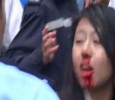 صينية مدانة بالاعتداء على شرطي بـ 'ثدييها'