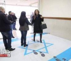 وزيرة أردنية تدوس على العلم الإسرائيلي وتل ابيب ترد