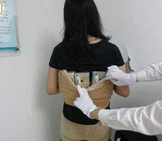 بالصور: بهذه الطريقة حاولت سيدة صينية تهريب 102 آيفون!