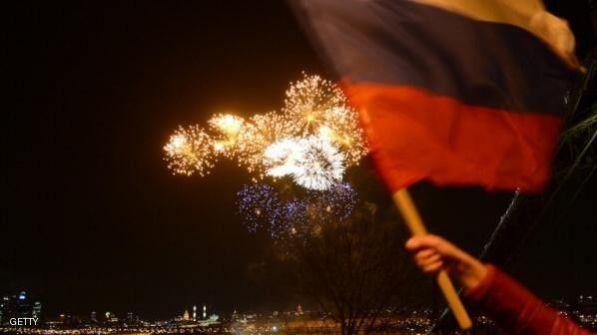 احتفالات بضم القرم وأوروبا تشدد عقوباتها