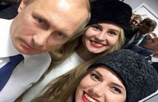 سيلفى لفلاديمير بوتين مع ملكة جمال روسيا يثير الجدل
