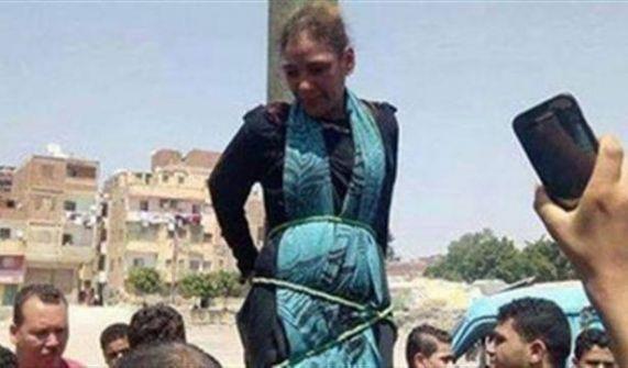 بالفيديو: ضربوها وعلقوها على عامود إنارة في مصر.. والسبب!!