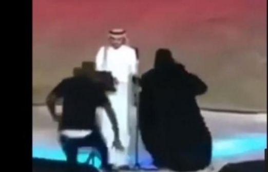 شاهد:اعتقال فتاة سعودية منقبة عانقت المطرب ماجد المهندس وإحالتها إلى النيابة بتهمة التحرش